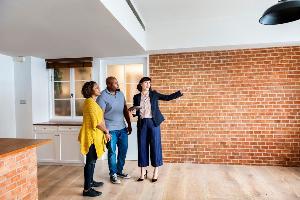 Real estate investors looking at property for a fix and flip loan